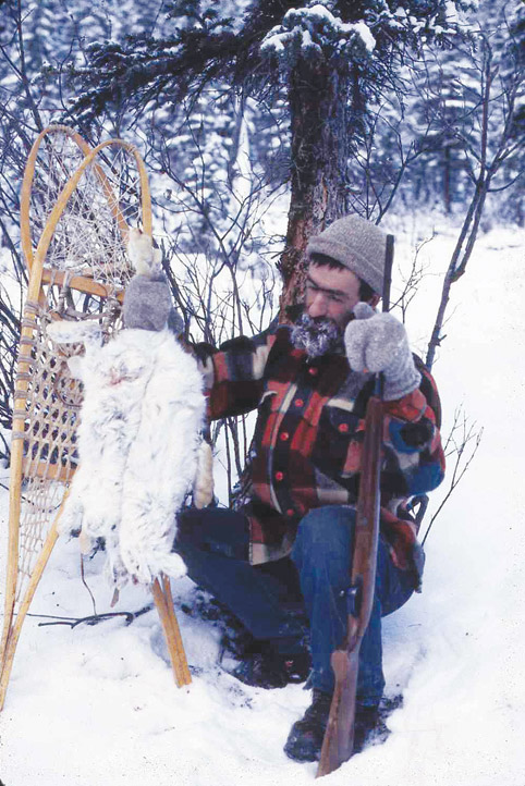 Tom Williams with snowshoe hares