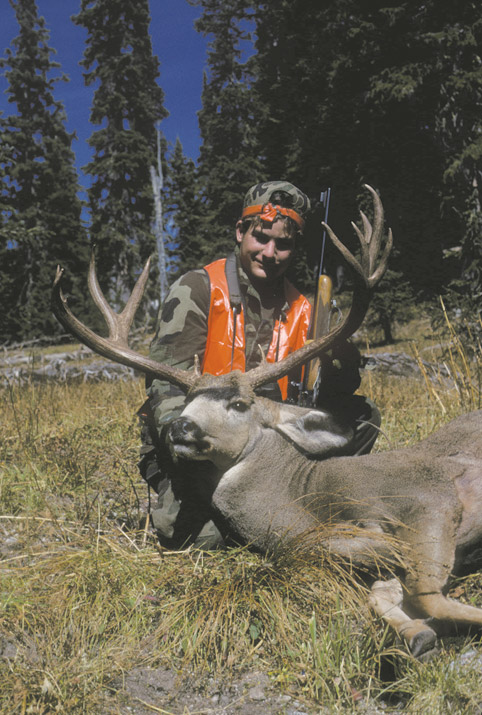 Hunter with Mule Deer