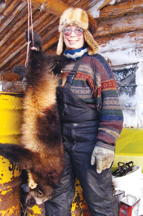 Julie Collins with a large wolverine