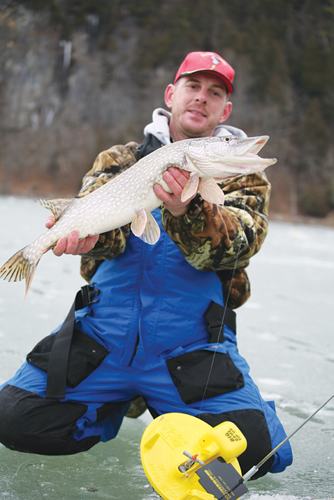 fisherman with big pike