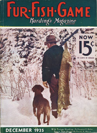 December 1935 hunter with dog and dead bobcat